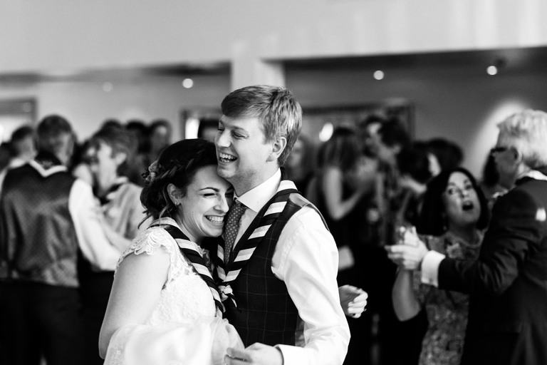 bride and groom wearing neckerchiefs for first dance