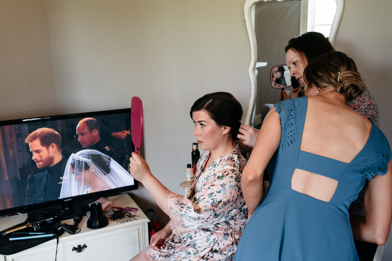 bride getting ready during the royal wedding
