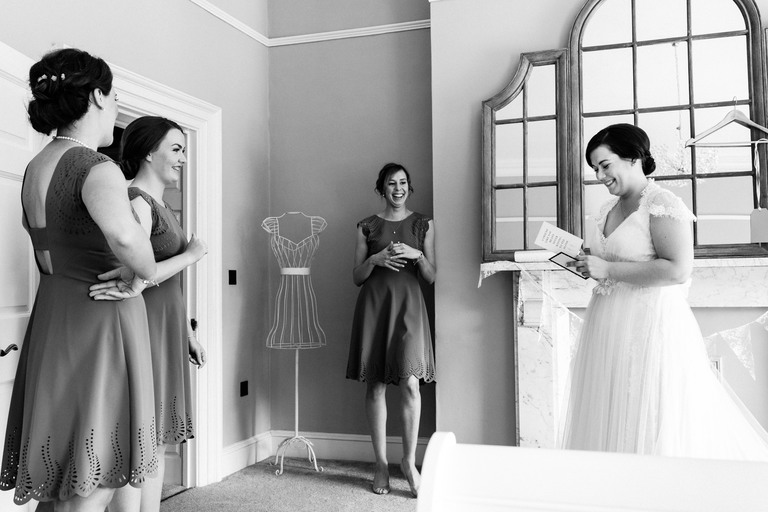 bride opening presents from bridesmaids