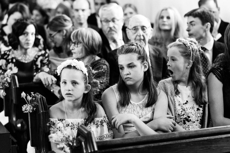 girls looking bored in church