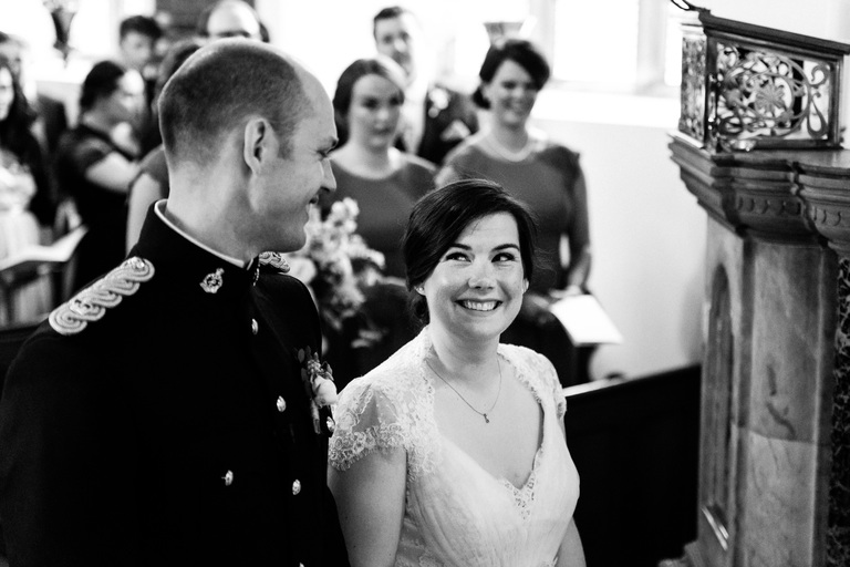 happy bride smiling up at her groom