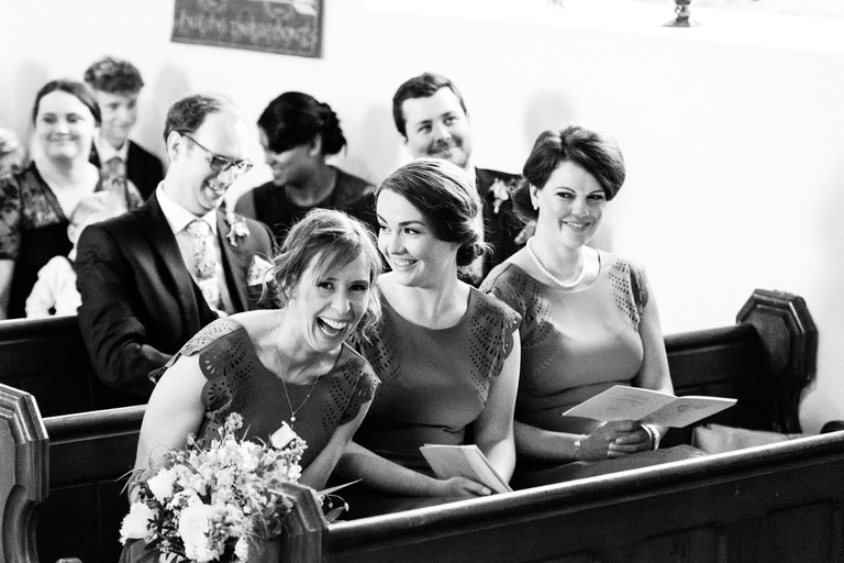bridesmaids laughing in church