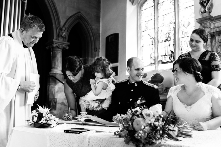 signing the register in church
