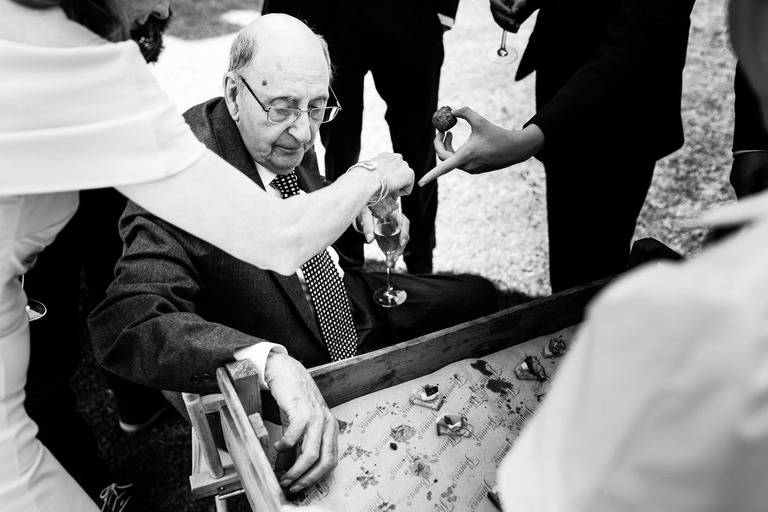 elderly gentleman having a canape