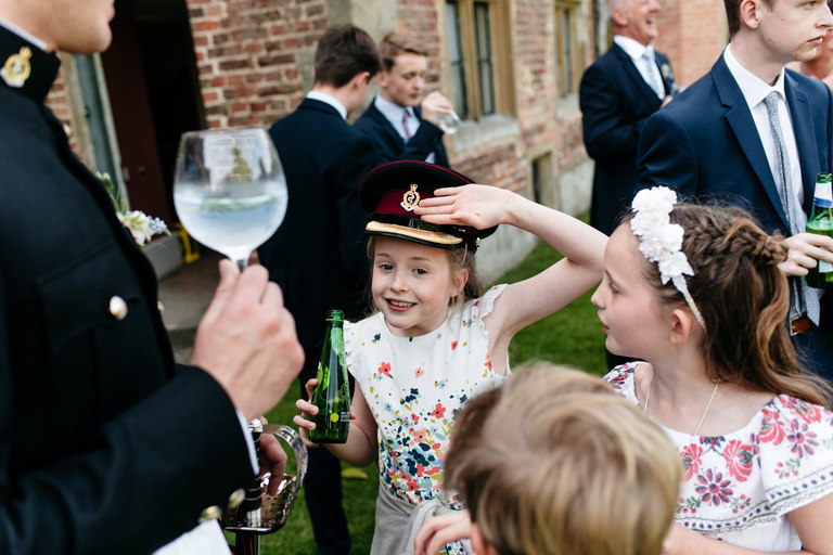 young guests trying on groom's hat