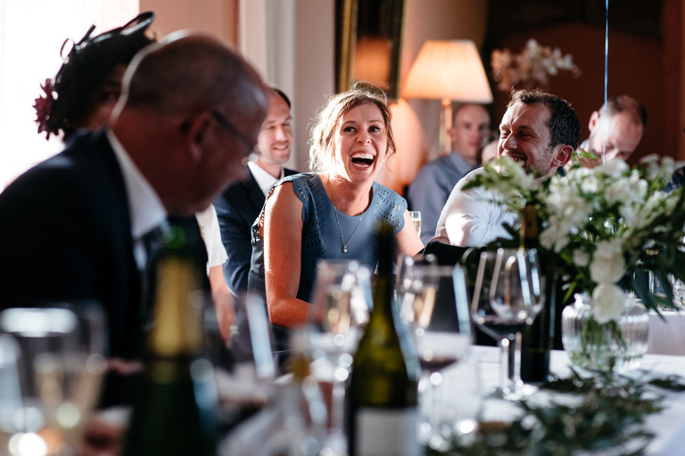 laughing bridesmaid during speeches