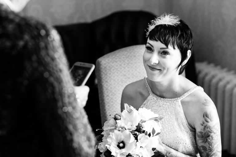 short haired bride smiling at her mum