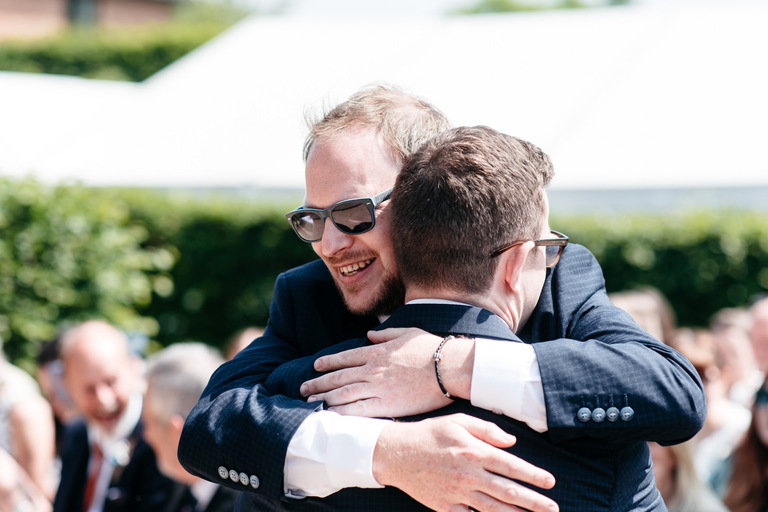 groom hugging his best man