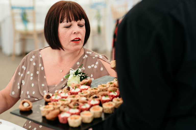 guest looking at the canapes