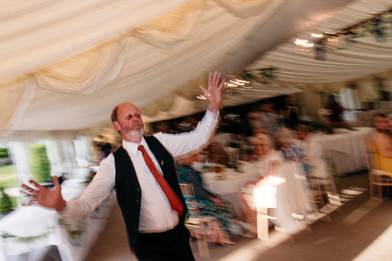 father of the groom joins the dancing