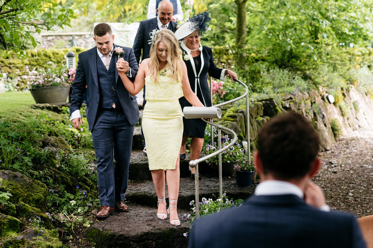 guests walking to outdoor wedding in derbyshire