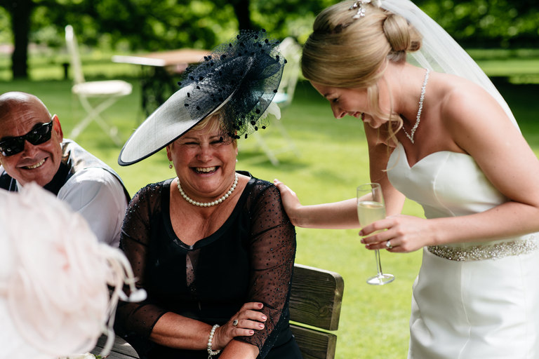 bride laughing with her mother in law