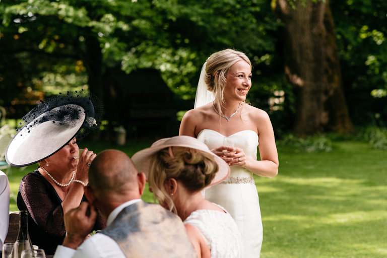 happy bride looking at her husband