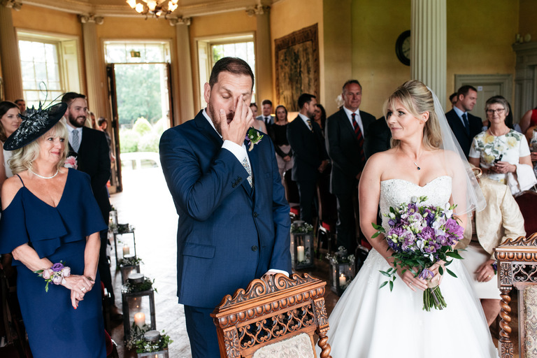groom wiping a tear from his eye