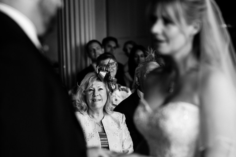 bride's mum looking on during the wedding ceremony