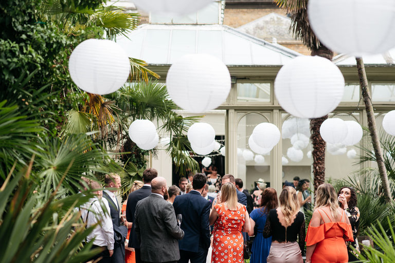 guests mingling during drinks reception with paper lanterns