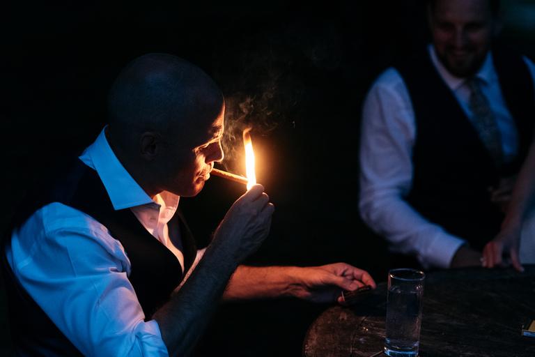 lighting cigars at night