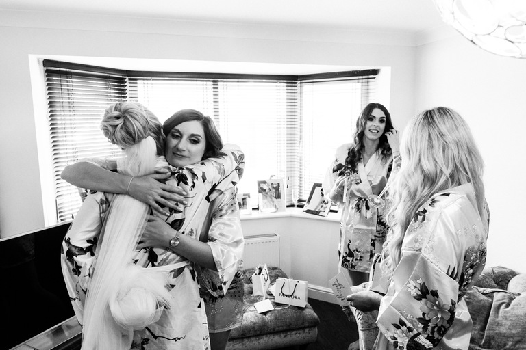 bridesmaids giving hugs