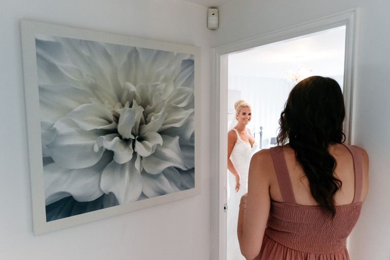 bride in her wedding dress in her parents house