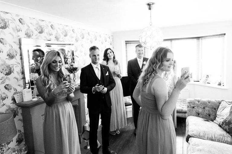 family watching bride in her wedding dress