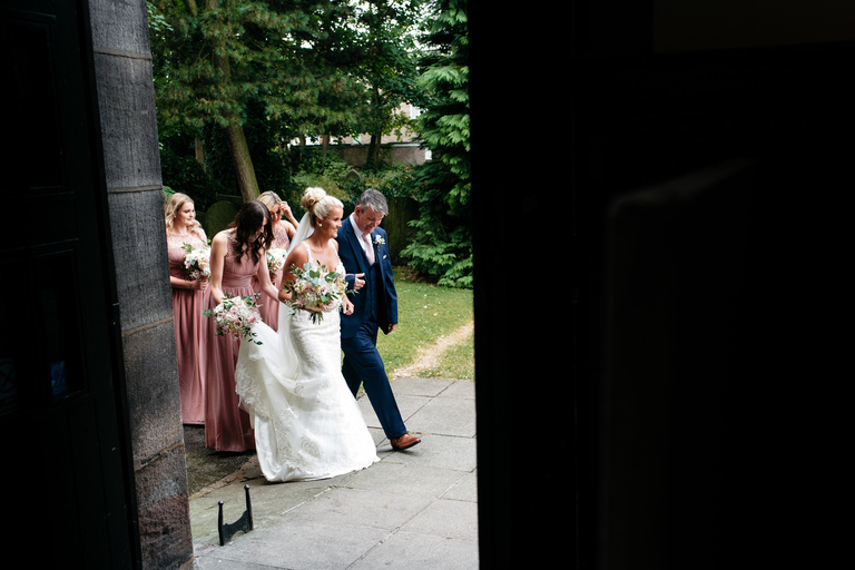 documentary photography of bride arriving at church