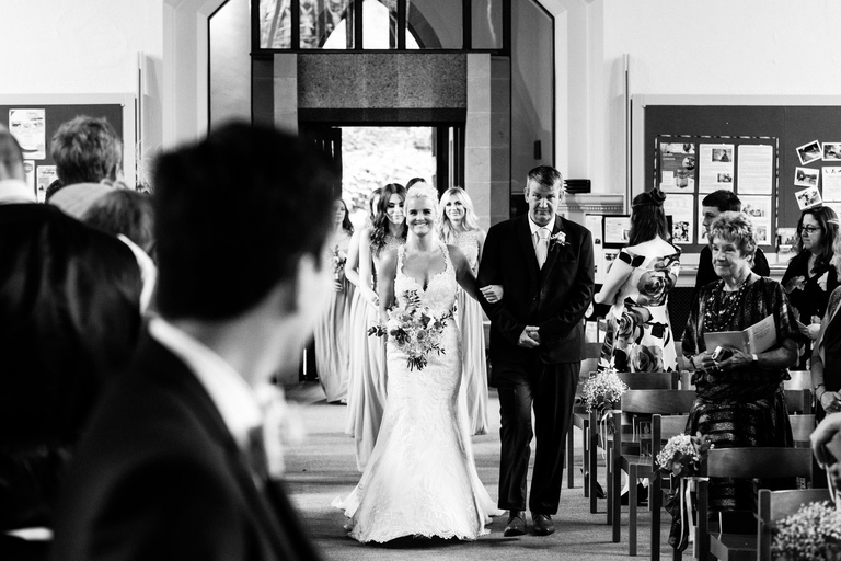 emotional wedding photography bride down the aisle