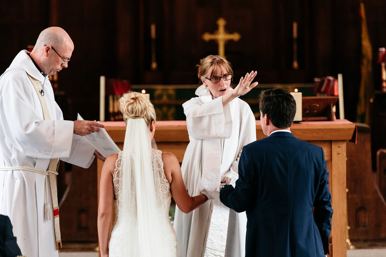 bride and groom being blessed in the church