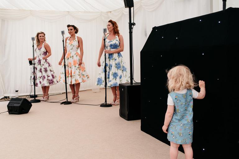 little girl watching wedding singers