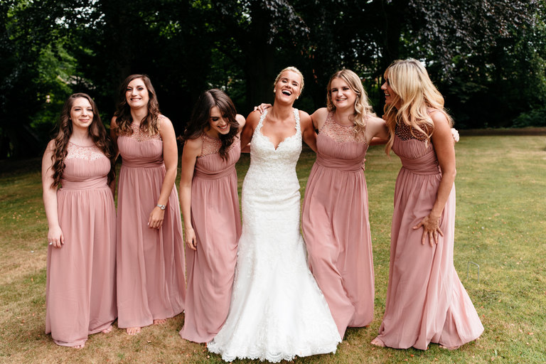 bride having a relaxed portrait with her bridesmaids