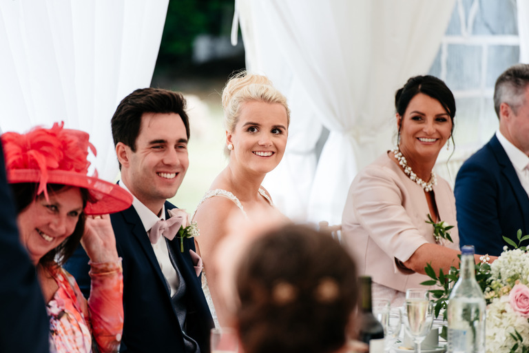 smiling couple during speeches