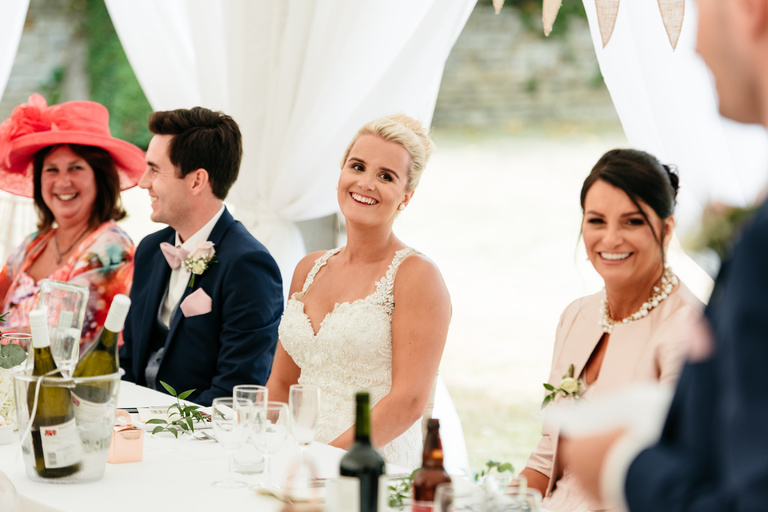 bride with her mum laughing during speeches