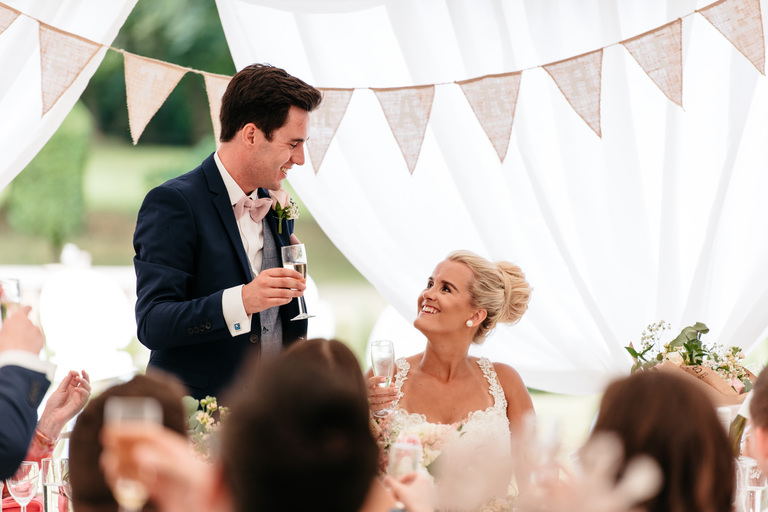 tender look between husband and wife during groom's speech