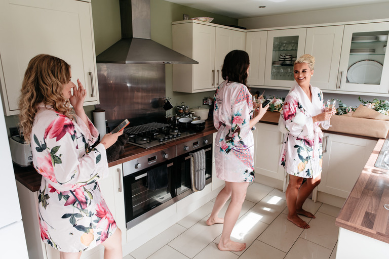bride with bridesmaids in the kitchen