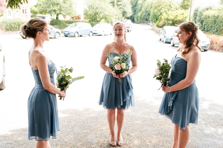 bridesmaids wearing blue waiting for the bride to arrive