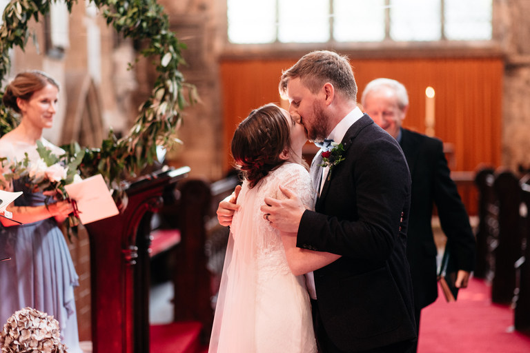 just married first kiss in church