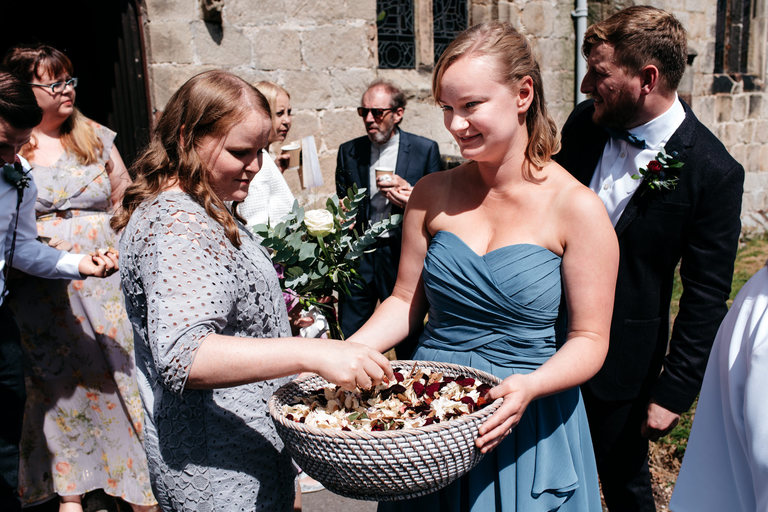 bridesmaid handing out confetti