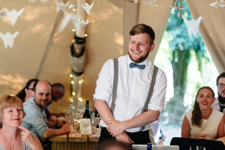 groom stands to give his speech