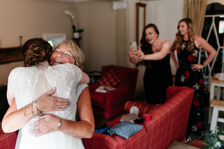 bride hugs her mum at home before the wedding