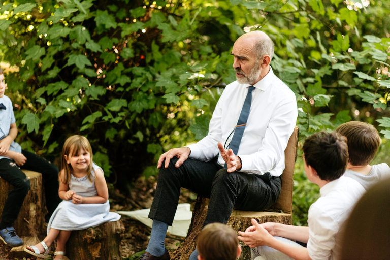 father of the bride telling stories in the woods