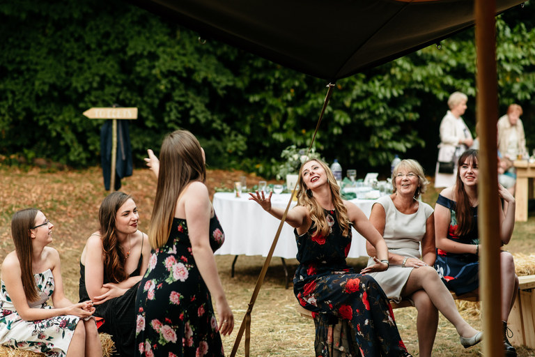 sharing a joke with friends on a summers evening