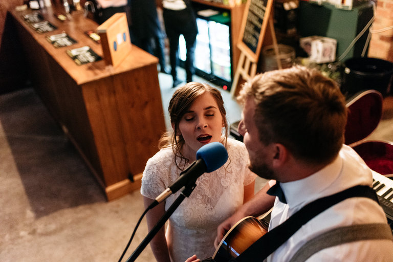 bride and groom performing music for their guests