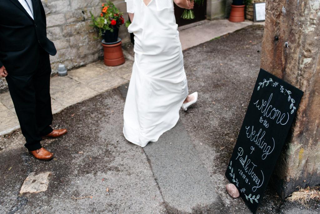 bride and groom arrive at hartington village hall