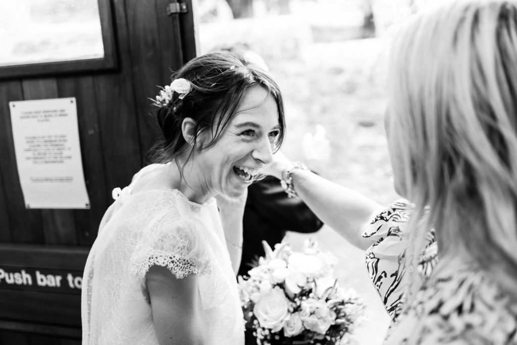 joyous bride laughing with a friend
