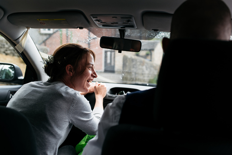 bride in the passenger seat of a car