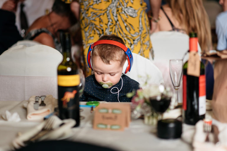 a young boy sat at the table with his headphones on