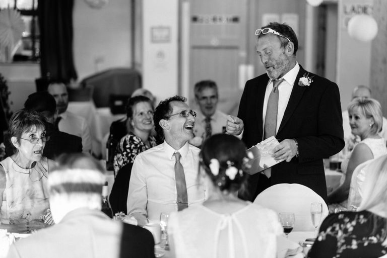 groom joking with his best man