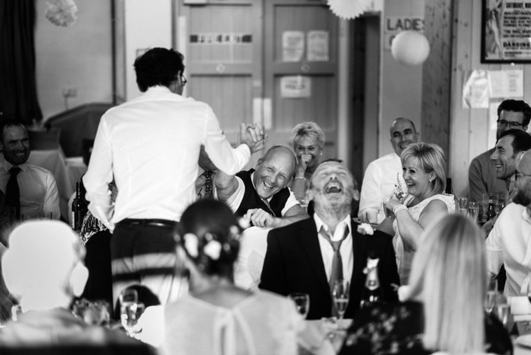 groom high fives during his speech