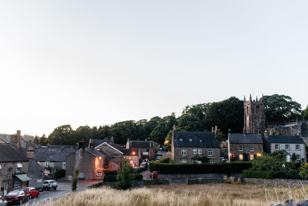 dusk falls over the derbyshire village of hartington