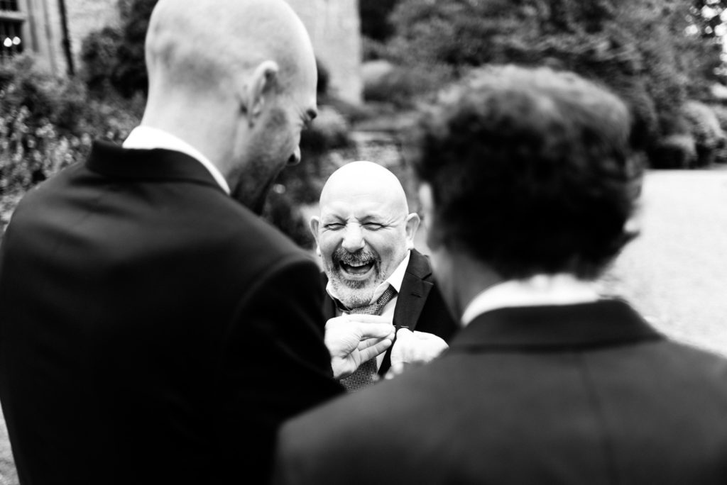 brother of the groom laughing