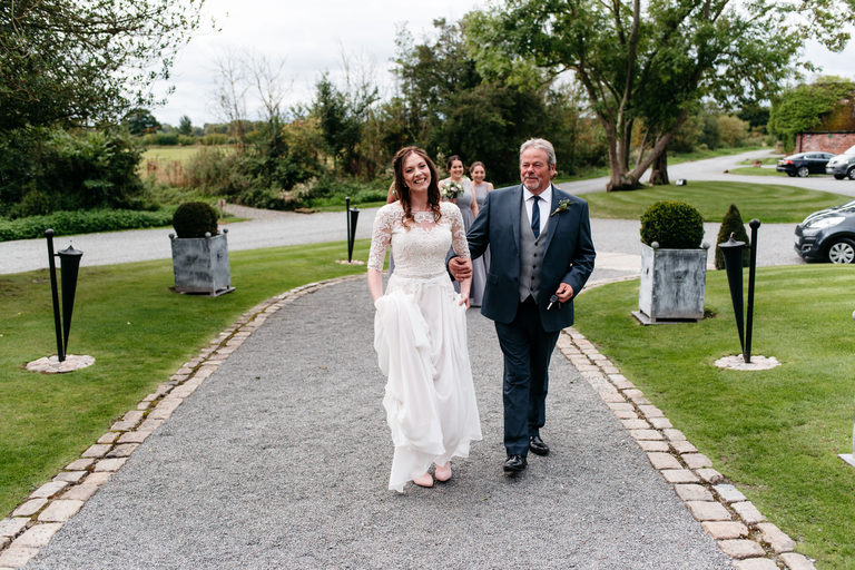 bride arrives at shustoke farm barn with her dad